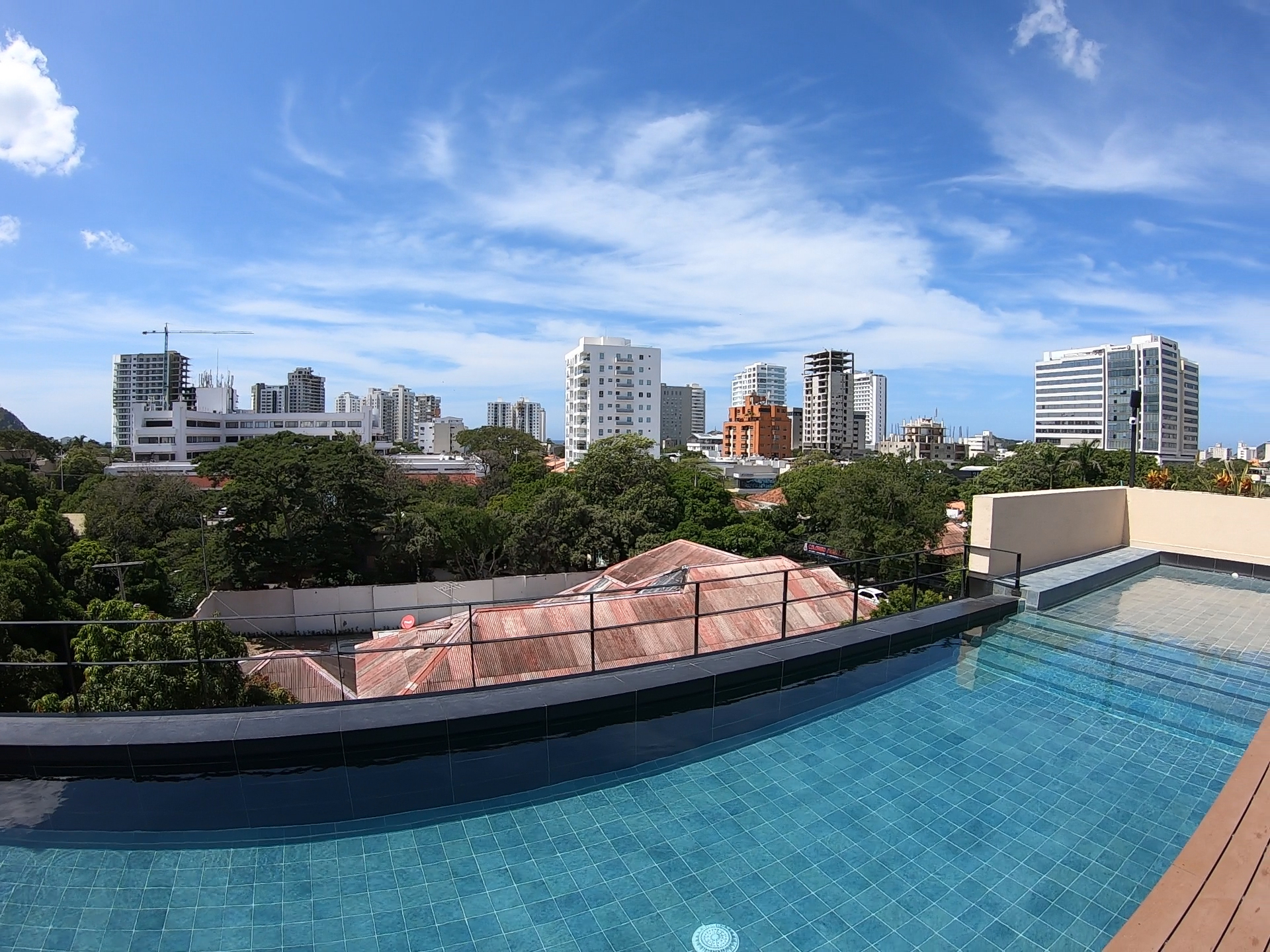 A rooftop pool with a view of the tall buildings in the city of Santa Marta, Colombia.